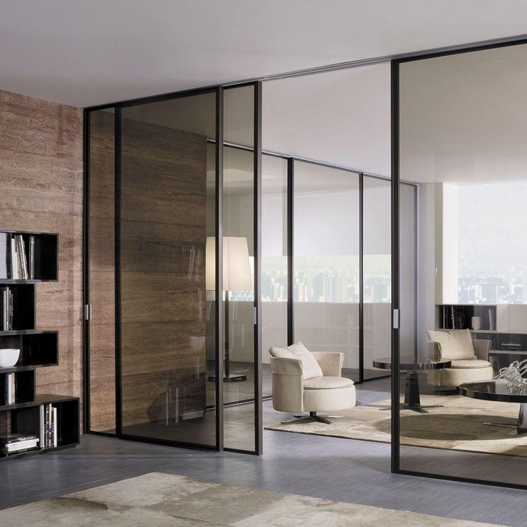 Le porte scorrevoli in vetro serramenti porta scorrevole for Longhi arredamenti