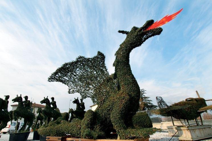 Statua drago pianta