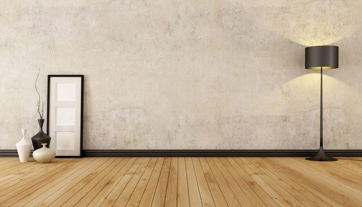 Muro di una stanza rivestito da intonaco