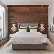 Camera da letto con rivestimento in legno
