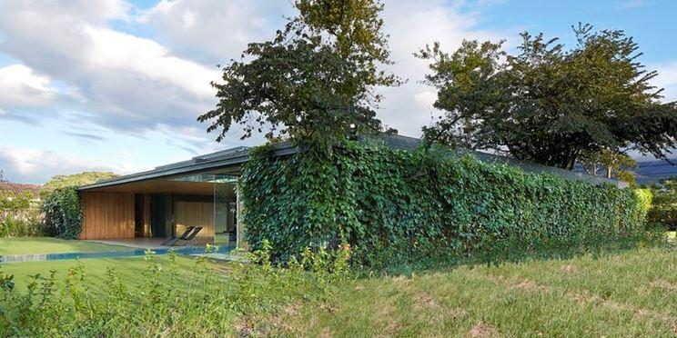 Casa con rivestimenti esterni green